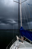 Sailing concept with boat and lake water storm weather royalty free stock images