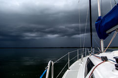 Sailing concept with boat and lake water storm weather stock photography