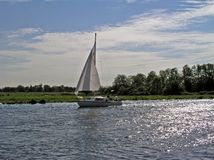 Sailing in the countryside. In Holland Stock Photography