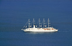 Sailing Cruise Ship in the blue waters of the Caribbean Royalty Free Stock Photography