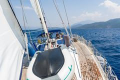Sailing cruising yacht with women on the helm Stock Photo
