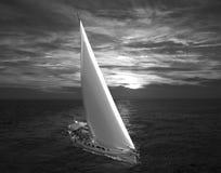 Sailing at dawn. A large sailboat in the ocean at dawn Stock Photos
