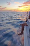 Sailing day in a sunset. A sailing day in a sailboat and going fast with a sunset time Royalty Free Stock Photos