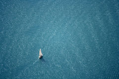 Sailing on the deep blue lake. Aerial view of a white sailboat on the lake, switzerland Stock Photography