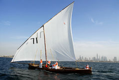 Sailing Dhow Against The Distant Cityscape Of Duba Royalty Free Stock Photos