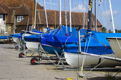 Sailing Dinghys and Yachts parked in the dinghy park of Bosham Sailing Club in West Sussex in the South of England Stock Image
