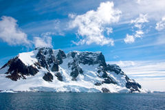 Sailing down the Lemaire Channel, Antarctica. Sailing down the Lemaire Channel. Beautiful blue sky & snow on the mountains, Antarctica stock image