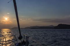 Sailing at dusk towards cape Sounio, Greece Stock Photos
