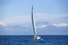 Sailing in the early morning through the mist on a calm sea. Romantic. Royalty Free Stock Images