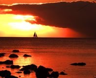 Sailing in the evening. Holiday at seaside and a sail through the dusky evening Royalty Free Stock Image