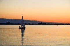 Sailing at evening Stock Photography