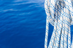 Sailing Fall Ropes on Blue Sea Background Royalty Free Stock Image