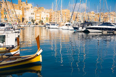 Sailing and fishermen boats on Senglea marina, Valetta, Malta stock images