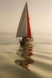 Sailing in fog. An yacht sailing in the fog Royalty Free Stock Images