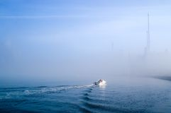 Sailing fog banks. Boat sailing in misty waters Royalty Free Stock Photos
