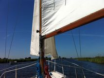 Sailing in Friesland. Sailing at Langwarder Vaart in Friesland The Netherlands Royalty Free Stock Photos
