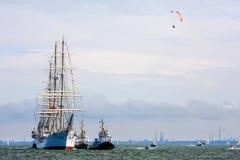 Sailing frigate 'Dar Pomorza' returns to port. GDYNIA - July 18: 100 years old Polish sailing frigate 'Dar Pomorza' returns to port with help of harbor tugs. 105 Royalty Free Stock Photos
