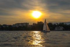 Sunset on lake of Geneva. Sailing at geneva lake, switzerland. Yachts and sailboats on lake Geneva Stock Images