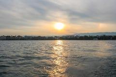 Sunset on lake of Geneva. Sailing at geneva lake, switzerland. Yachts and sailboats on lake Geneva Royalty Free Stock Photography