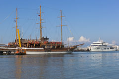 Sailing Gloria and motor ship Empire at the pier in Gelendzhik Bay on a summer morning Royalty Free Stock Photos