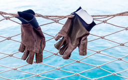 Free Sailing Glove Hanging On The Nets. Stock Photo - 57077560