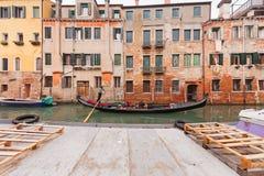 Sailing gondola in Venice. Near pier in channel Stock Photo