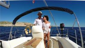 Sailing. Happy couple sailing on Mediterranean sea, Croatia stock video footage