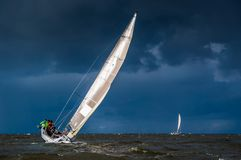 Sailing in heavy weather stock photos
