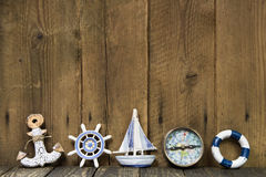 Sailing holiday: Greeting card with nautical items on wooden board. Royalty Free Stock Photos