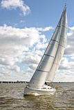 Sailing on the IJsselmeer in the Netherlands. On a beautiful sunny day Stock Photos
