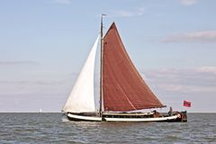 Sailing on the IJsselmeer in the Netherlands. Traditional sailyacht sailing on the IJsselmeer in the Netherlands Royalty Free Stock Image