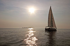 Sailing on the IJsselmeer in the Netherlands. Sailing on the IJsselmeer at sunset in the Netherlands Stock Images