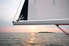 Sailing on the IJsselmeer in the Netherlands. Sailing on the IJsselmeer at sunset in the Netherlands Royalty Free Stock Photos