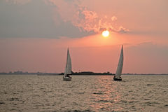 Sailing on the IJsselmeer in the Netherlands. Sailing on the IJsselmeer at sunset in the Netherlands Royalty Free Stock Image