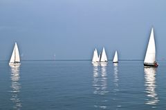 Sailing on the IJsselmeer in the Netherlands. Sailing on the IJsselmeer at sunset in the Netherlands Stock Photo