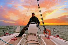 Sailing on the IJsselmeer Netherlands at sunset Stock Photo