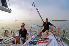 Sailing on the IJsselmeer in the Netherlands. At sunset Royalty Free Stock Photo