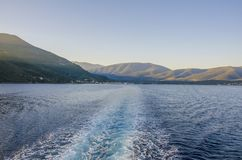 Sailing through the Ionian sea between the ports of Sami Kefalon. Ia and Pisaetos Ithaka in the background the mountains of the island of Kefalonia Royalty Free Stock Photography