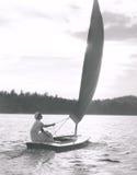 Sailing on a lake stock image