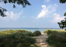 Sailboat on Lake Michigan, Sandy Grassy Beach Stock Photo