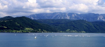 Sailing on lake. With mountains in background stock images