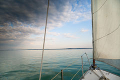 Sailing on the lake before storm Stock Image