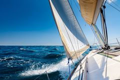 Sailing lboat at open sea in sunshine stock image