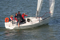 Sailing Lesson. Sailing teacher with three students on a sailingboat at sea stock photo