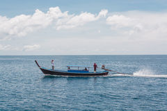Sailing long tailed boat in the sea at Lipe Island in Thailand. Long tailed boat in the sea in lipe island in Thailand royalty free stock images