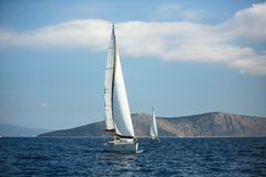Sailing luxury yacht boats glide on the water surface of the Aegean Sea. Sailing luxury yacht boats glide on the water surface of the Aegean Sea, Greece royalty free stock photos
