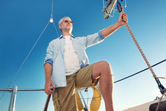 Sailing man captain Royalty Free Stock Images
