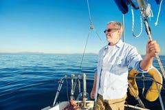 Sailing man captain Royalty Free Stock Image