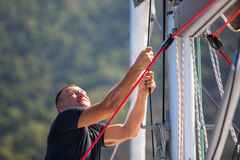 Sailing, man pulling ropes. Luxery yacht boat. Sport. Sailing, man pulling ropes. Luxery yacht boat Royalty Free Stock Photo