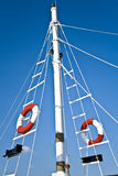 Sailing mast with life buoy Royalty Free Stock Photography